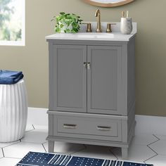 This charming, 24'' single vanity is the perfect piece for making a great first impression in your guest bathroom. It's made from solid and engineered wood with a white stone countertop around a porcelain undermount sink, plus a matching backsplash to protect your walls. Below, a double-door cabinet and drawer give you a spot to store some towels and decorative soaps. This bathroom vanity comes in your choice of colors with brushed nickel-finish hardware included.Bonus: It arrives fully assemble 24 Inch Vanity, 24 Inch Bathroom Vanity, 24 Vanity, Small Bathroom Vanities, Bathroom Ideas, Bathrooms, Basement Bathroom, Bath Ideas, Bathroom Remodeling