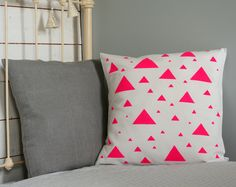 <3 Neon pink triangle pillow cover - Hand painted pillow cover for a color block home - Neon pillow cover. €32,00, via Etsy.
