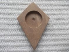 1 piece dark walnut wooden deltoid/kite shaped pendant/brooch base for jewel making. In the centre of the pendant there is a 18 mm cabochon frame/cutout, which gives a more attractive look to the pendant. You can put a little picture, textil or napkin into the cutout. You can make a mini picture /photo from this craft supply, too. Perfect for DIY projects   www.artwoodenstuff.com