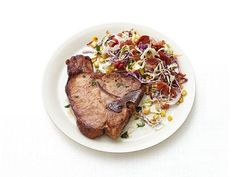 Get Pork Chops with Corn-Bacon Slaw Recipe from Food Network