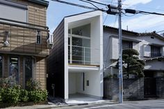 It is a house for a couple located in a residential area of Tokyo. Although a site is about 46 square meters and surrounded by buildings, there is a park acr...