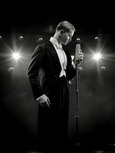 Max Raabe & The Palast Orchester.. eerie music...like being transported to a 1930s Berlin caberet