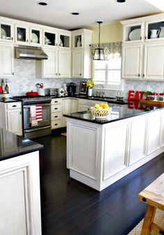 white kitchen with red accents