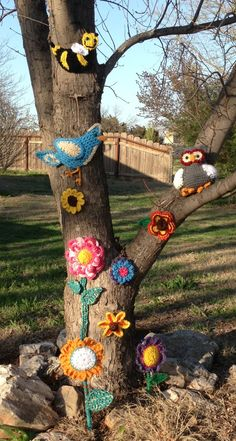Yarn bombed my tree. Do any teamies want to try this?  Invite from Lowell http://www.lowellartscouncil.org/Default.aspx?pageId=1582338