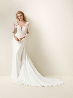 Dramae: Flared style wedding dress with three quarter length sleeves Pronovias