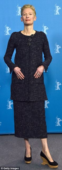 Elegant: Tilda Swinton looked super chic in a tweed jacket and skirt and quirky wedge heel...