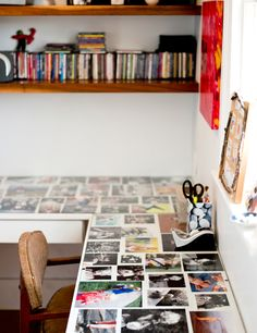 This 1800 house in Portland, Maine, is home to photographer Winky Lewis. This is the desk in the office space with family photos under glass.