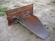 Tractor Stump Spade by 1ofU -- Homemade tractor stump spade fashioned from a length of halved pipe and steel plate. http://www.homemadetools.net/homemade-tractor-stump-spade