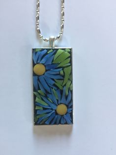 A personal favorite from my Etsy shop https://www.etsy.com/listing/473620204/mosaic-pendant-blue-stained-glass-flower