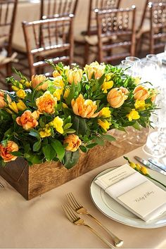 Walnut Stained Rectangular Wood Boxes With Mango and Amber Tulips and Freesias | Event Planning, Design & Floral Production: tracytaylorward.com | Photography: Francisco Bravo | www.christianothstudio.com/artists/francisco-bravo | Venue: The Barnes Foundation