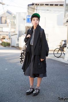 When we spotted 21-year-old Yui on the street in Harajuku, she was wearing several Comme Des Garcons items, a resale jacket and tote bag, and Tokyo Bopper shoes.