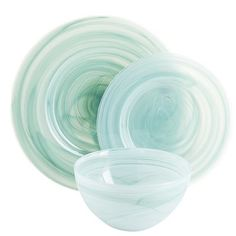 Made of swirling, semi-opaque variegated glass, our Alabaster Dinnerware is really quite a head-turner. You can use it at the dinner table (it's dishwasher-safe), or set it aside for onlookers to gawk at. Either way, you'll give 'em something to talk about.