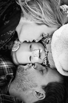 Have the top of each child's head touching with one of us on each side kissing one of them