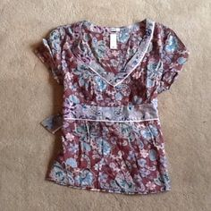 Old navy dressy floral blouse. Excellent codition dressy blouse/top. Material tag cut out but l believe it is a silk or silk cotton blend. Satin piping lines the contrast fabric at the neck, waist and back tie.  So cute! Old Navy Tops Blouses