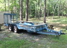 "Hudson bros dual axle utility trailer. 16' x 80"". Delta diamond plate work box attached on trailer. 1993 Hudson Brothers Heavy Duty Skid Steer Steel Deck Trailer with Split Expanded Metal Gate, HA16 - 5 TON  Pro Series, Electric Brakes, GVWR  12,200 LBS, GAWR 10,000 LBS at 50 mph, Overall Length  22', Deck Length 16', 75.5'' Wide, 1/8'' Diamond Plate Metal Deck"
