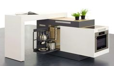 """Designed by Kristin Laass and Norman Ebelt from Germany, this clever project is called """"Small Type"""" and it has the wonderful and extremely practical ability of fitting in almost any interior, no matter how tiny. Measuring only one square meter when closed, this compact kitchen serves as a table, a refrigerator, an oven, a sink …"""