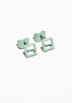 A square shape is used to create these clean and minimalistic stud earrings, crafted from brass.