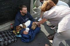 For Animals's photo: This homeless man's rabbit was thrown over a bridge by a passerby and he immediately jumped in to the river to save her and resuscitated her. He won an award, was given animal food and a job, and the passerby was charged with animal cruelty.