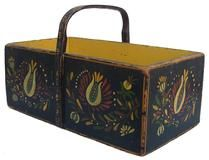 "X538 19th century Painted  Handled Box, The box is painted with a early Pennsylvania Dutch type decoration, Has a steamed and bent wooden handle, nailed construction with square head nails, Measurements are:7 1/2"" wide x 13 1/4"" long x 8"" tall"