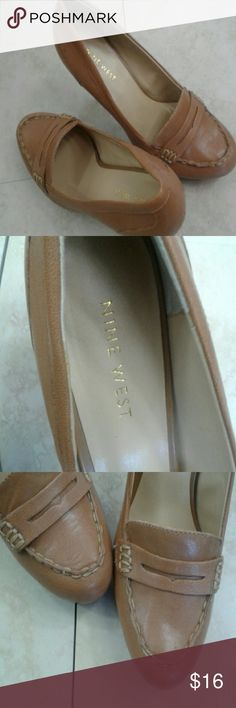 Penny loafers pumps Penny loafer heels they are 5 inch pumps Great for work. Tan leather size 7 and a half comfortable perfect pump! Nine West Shoes Heels