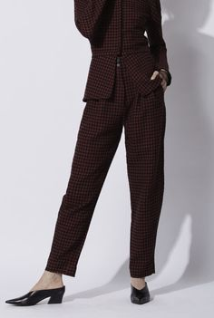 Marcel Pants: High waisted masculine-cut made pants in wool and linen blend. The material is a magenta and black tweed. The fit of the pants tighten at the ankles, and the pants have side pockets. This design combines with the Odd jacket made in the same material.Made in Barcelona. Cortana AW 2016 collection. Shop online.
