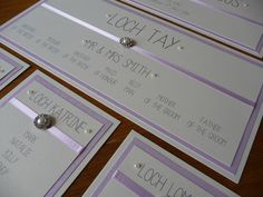 Pretty Lilac Wedding Table Plan with pearl embellishments