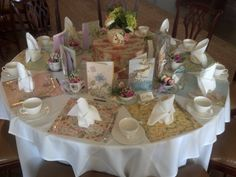 "Bridal shower tea party. Using scrapbook paper for placemats and tea cups and tea pots to hold flowers as party favors. Have custom hand made tea bands with a tag saying ""the perfect blend for the perfect couple"""