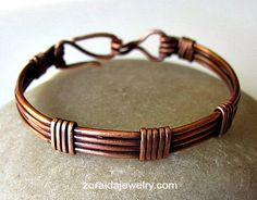 This elegantly designed copper wire bracelet has been made of thick 14 gauge copper wire and wrapped with 16 gauge wire.  It is a simple, classic and elegant design that looks great on anyone, everyda