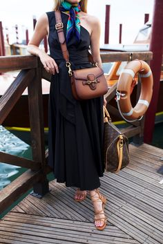 I love this because its the perfect essence of summer fashion and the scarf makes the whole look pop// Atlantic-Pacific: arriving in Venice