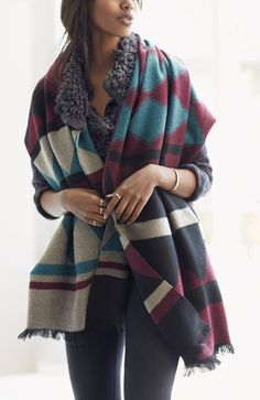 Excited to bundle up up in this soft, cozy wrap scarf patterned in a bold geometric print.