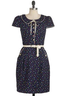 belted polka-dotted navy dress with cap sleeves and peter pan collar