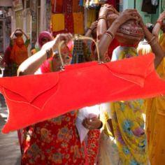Massive Manderin red velvet long bag by Fernando Garcia designs Miami Beach Florida