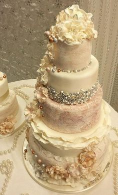 Amazingly detailed wedding cake with lace and sparkles.