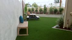 It's a synthetic turf backyard in this modern landscape.  Note the benches and stucco planter wall.  http://www.trulandscape.com/modern-backyard-remodel/