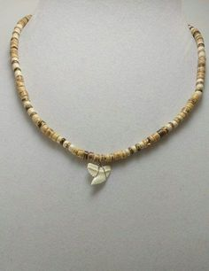 Template By Froo! Estate shark tooth puka style Necklace Estate shark tooth puka style Necklace Bidding on more than one item?Save Money with Combined