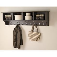 These functional and attractive wall-mounted shelves offer a place to hang your coat and rest your keys.