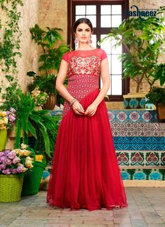 Make the heads flip whenever you costume up with this integral red net designer gown. The interesting embroidered work in the course of the dress is awe inspiring. (Slight variation in color, fabric &...