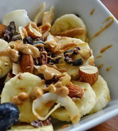 Monkey Salad, breakfast with almond butter, banana, cocoa nibs, coconut, nuts, and blueberries.