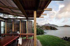 """Architecture: Herbst Architects  Beautiful beaches around the area of """"Castle Rock Beach House"""" in New Zealand. The terrain was a challenge for architects to have to build a summer house who successfully exploited the most of limited space on the hill. To achieve this, the residence is divided into two blocks that offer a panoramic view."""