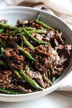 Sesame-Ginger Beef…This is the most flavorful a stir-fry could ever be! Sesame-Ginger Beef…This is the most flavorful a stir-fry could Beef Recipes For Dinner, Steak Recipes, Cooking Recipes, Crockpot Recipes, Steak And Green Beans, Beef And Green Beans Recipe, Sesame Beef, Asian Recipes, Healthy Recipes