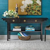 """Ming Altar Table; Our altar table is built in much the same way as the antique offering table that inspired it, entirely by hand, using traditional Chinese joinery techniques. Made from  chinaberry and engineered wood with select veneers, it's hand- finished in rich black lacquer. A slim profile lets this piece work as well behind a sofa as it does against a wall. Antiqued brass pulls accent the three drawers. 63""""W x 15 1/2""""D x 30 3/4""""H; $730 + $100 shipping surcharge"""