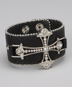 Change up ritzy and glitzy jewelry by rocking some rustic with this cross-accented bracelet. A pair of snaps helps it go on and adjust easily.1.5'' W x 9'' LLeatheretteImported