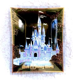 A stunning vintage black Walt Disney World decorative ashtray or trinket plate.  Measures around 4.75 x 3.75 roughly.  Please see all pictures up close for a thorough representation! :) I have TONS more vintage items in my Etsy store!  I ship WORLDWIDE from a clean, pet & smoke-free home! Please note that shipping times will be slower OUTSIDE of the US & Canada (up to 3 months in some cases), and tracking is not included to those locations. I offer VERY cheap combined shipping rates, so be…