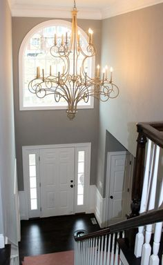 Two story foyer. two story foyer entry paint colors Entryway Paint Colors, Interior Paint Colors For Living Room, Entryway Decor, Foyer Design, House Design, Apartment Entryway, Foyer Lighting, Stairwell Chandelier, Foyer Decorating