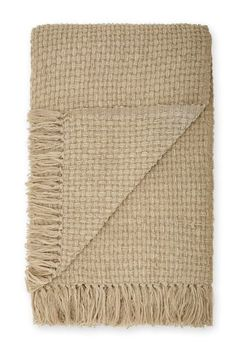 Get snuggled up on the sofa with this warm natural woven throw, perfect for those cold nights or lazy days!