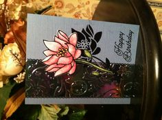 Elizabeth Craft Designs makes up the majority of this card. The embossed image on the shimmer sheet is from Spellbinder Paper Crafts. Copic markers were used to color the fine glittered Lotus flower.