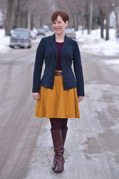 Already Pretty outfit featuring navy blazer, plum sweater shell, cognac belt, mustard full skirt, plum tights, burgundy boots, Sam Edelman boots