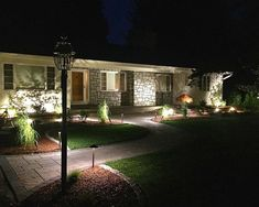 Low voltage Landscape lighting along a front walkway by Bahler Brothers in Connecticut