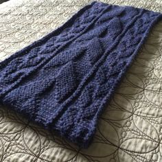 A quick, cozy cowl knit in the round. Yarn required: Roughly 220 to 260 yards of your favorite bulky weight. Needles: Size 10 circulars, or size needed to obtain gauge. Pattern includes both written instructions and charts. Price is for PATTERN ONLY, not a finished garment.