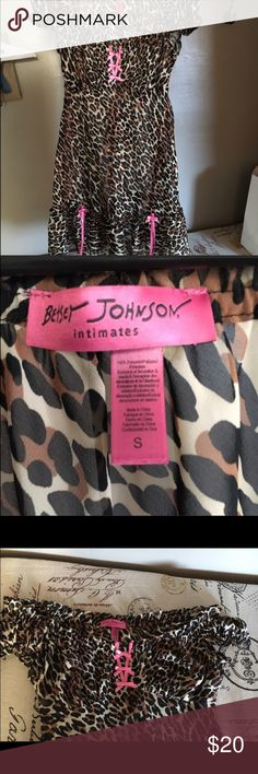 """Like New Betsey Johnson Nightie This nighty has never been worn. I purchased it because I am a sucker for animal print and because of the hot pink details and bows on the bottom ruffle. It has bagging fabric where your """"girls"""" should go and the neckline is meant to be worn around your shoulders. It's ruched and has an elastic lining so you could really pull it all the way down if that was your intention 😉 Betsey Johnson Intimates & Sleepwear Chemises & Slips"""